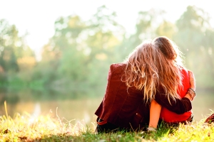 Girl and woman hugging from back YCL
